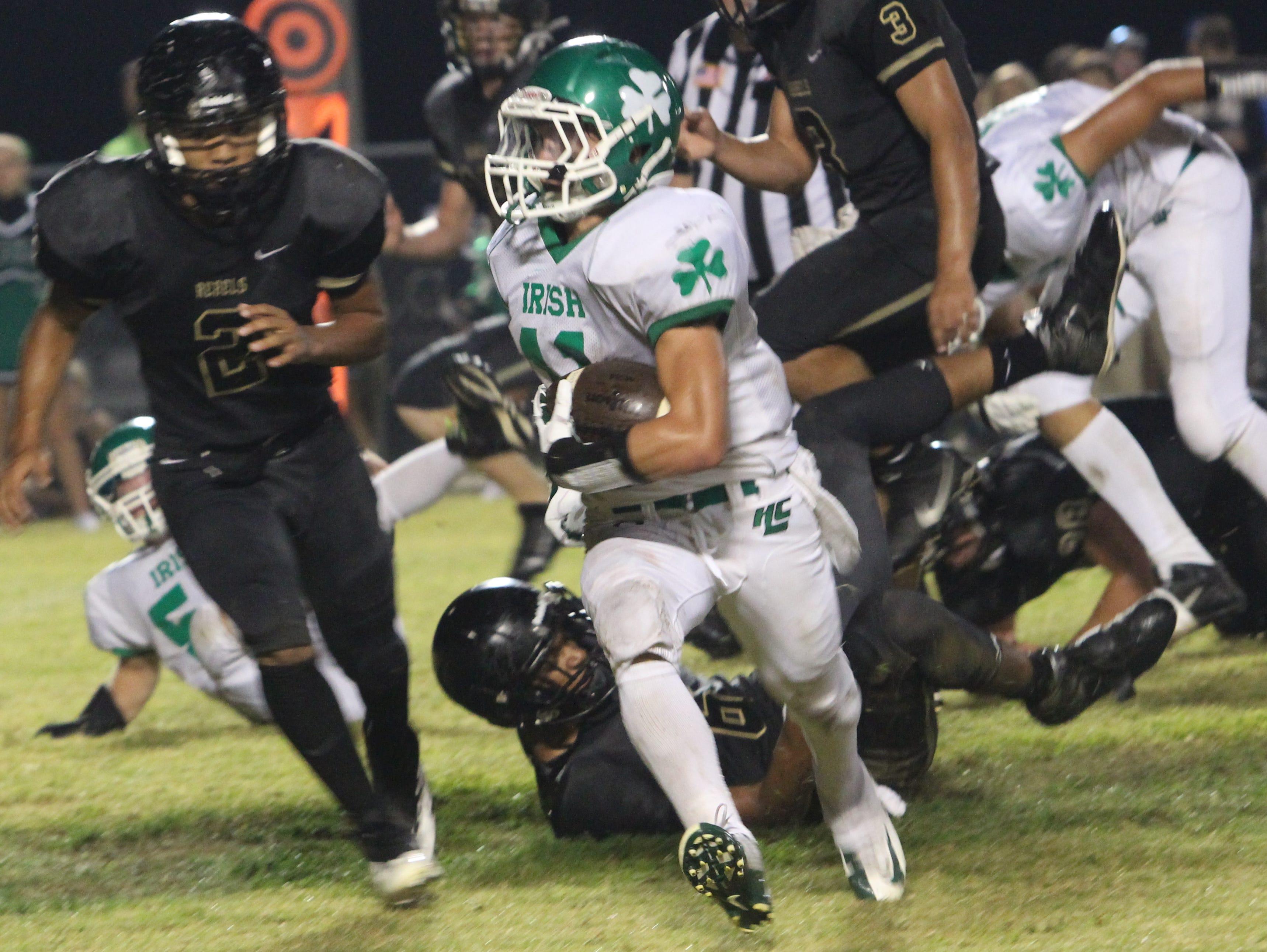 Houston County's Nolas Seay runs the ball against rival Stewart County earlier this season.