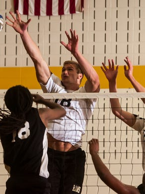 Southern's Mike Gesicki goes up to block the shot of St. Peter's Prep's Shayron Taylor during an  NJSIAA boys volleyball tournament championship match.