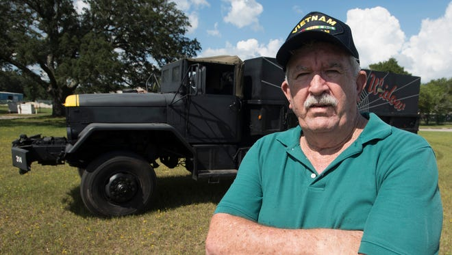 Vietnam Army veteran Ron Smith shows off a replica of the 5-ton gun truck on Tuesday, Sept. 26, 2017, that he built based on the one he drove while serving in Vietnam.