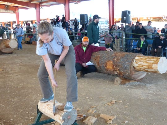 Vanessa Shevlin, 21, of Cal Poly San Luis Obispo competes in an ax-wielding competition at Saturday's Sierra-Cascade Logging Conference in Anderson.