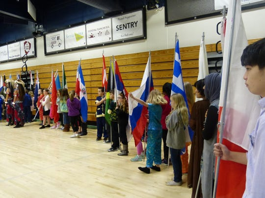 Children display flags from various nations at the Multi-Cultural Celebration on Saturday at Central Valley High School in Shasta Lake.
