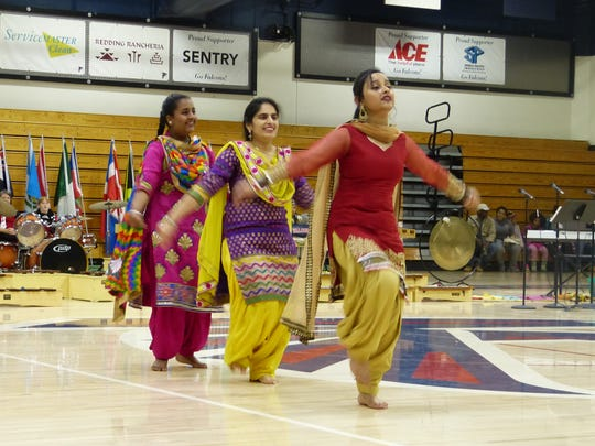 Rasneet Kaur, 17, from right, Baljeet Kaur, 34, and Akshdeep Kaur, 14, perform a Punjabi folk dance at the Multi-Cultural Celebration on Saturday at Central Valley High School.