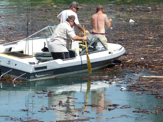 Boaters try to navigate their way to clear water after launching at the Centimudi  boat ramp on Wednesday.