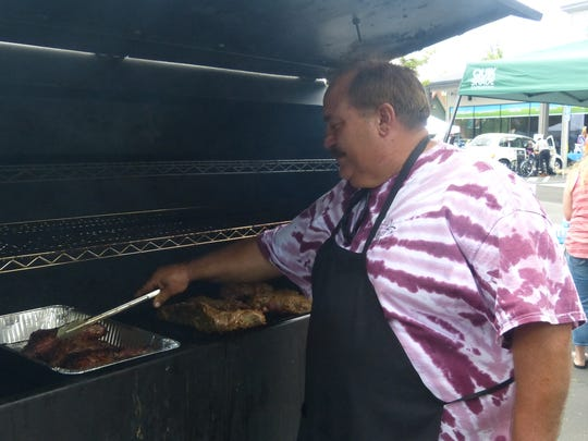 Dan Araiza of the Wings of Angels Foundation barbecues tri-tip at the fundraiser for Parker Reynolds on Saturday.