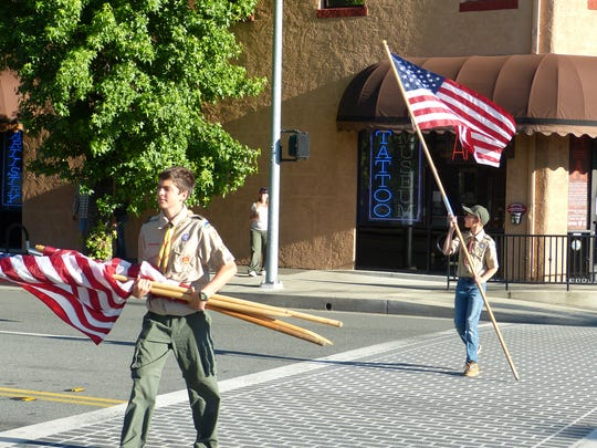 Daniel Snider, left, and Tyler Klein were among those members of Redding Boy Scout Troop 37 who placed flags throughout the downtown area Wednesday in celebration of Flag Day.