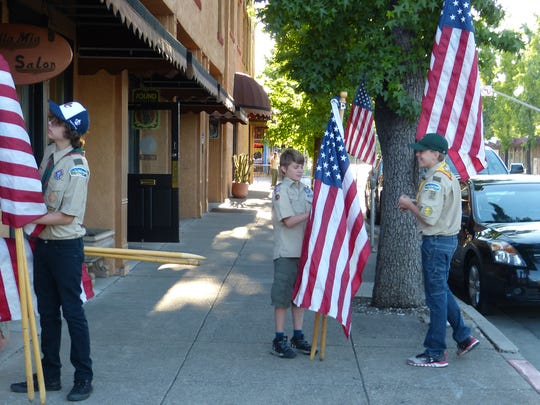 Redding Boy Scout Troop 37 places flags in the downtown area to mark a number of holidays, including Veterans Day, Flag Day and the Fourth of July.