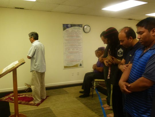 The men pray together at  the Islamic Center of Redding