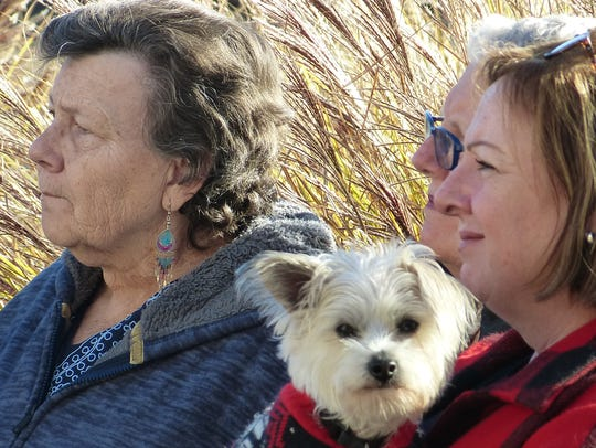 Friends and family of Pearl Harbor survivors, including Darlene Mattson, left to right, Cindy Byer and Mary Anne Wynant, gathered Thursday for a ceremony observing Pearl Harbor Remembrance Day.