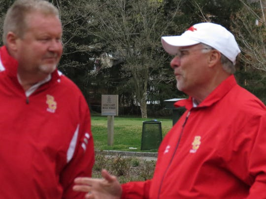 Bergen Catholic AD Jack McGovern, left, confers with Crusaders golf coach Jim Jacobsen.