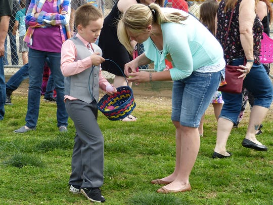 David Roberts, 6, and mother Ashley Stevenson examine the six Easter eggs he gathered during the hunt in Anderson on Saturday.