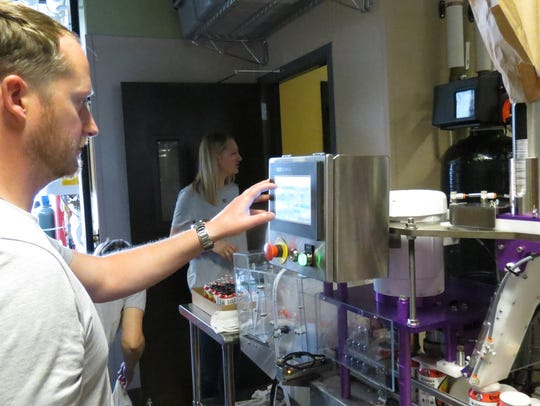 Peter Rhoadey operates a mobile canning line at Rally