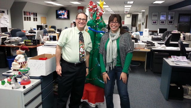 Consumer Experience Director Irwin Goldberg and Producer Erika Smith at the Journal newsroom on Christmas 2014.