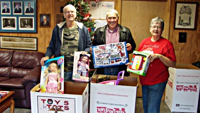 Mary Ann Robertson, right, helps veterans during a Toys for Tots drive at the Aberdeen American Legion Auxilliary.
