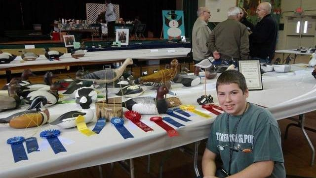 Galloway Township youth carver, Tanner Holcombe, showcasing his winning entries - 2014 Two Rivers Exhibition of Sporting Collectible Art.
