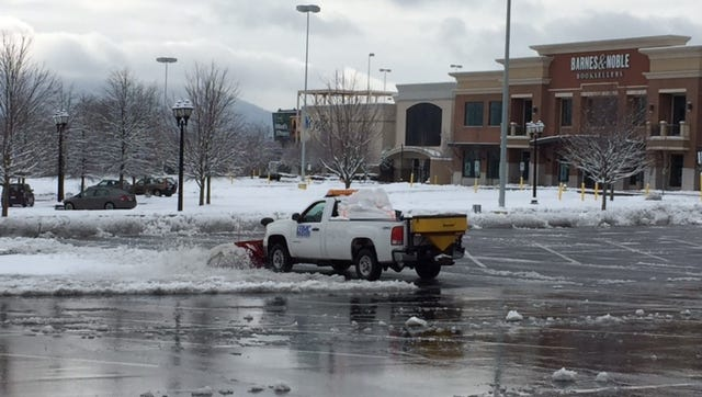 Snow removal is underway about 10 a.m. Thursday at Asheville Mall.