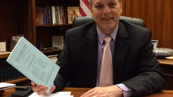 Senate President Andy Biggs reviews a copy of the brief