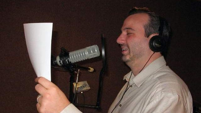 Voice Coaches assistance creative director John Gallogly working on a voice acting project.