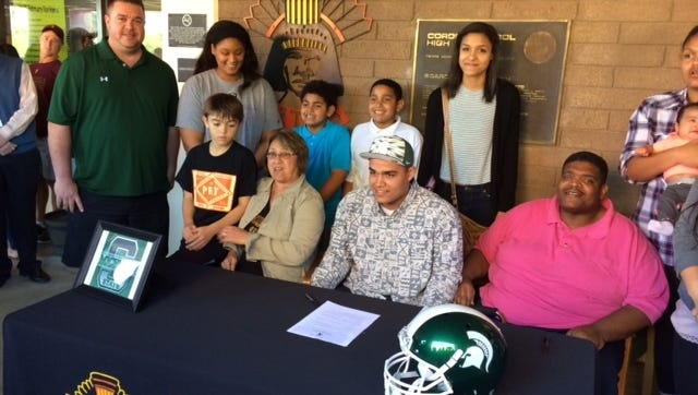 Cassius Peat signs his letter of intent with Michigan State.