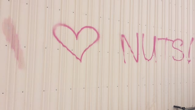 "Graffiti was sprayed on the Dieseltec building overnight Tuesday reading, ""I (heart) nuts."""