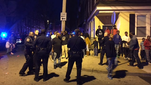 A large crowd gathered Tuesday night in the 600 block of W. Sixth St., where two women were shot. One of the women, Arteise Brown, 24, of Wilmington, later died at Christiana Hospital, city police said Wednesday.