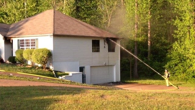 """The kitchen of a house on Old Oak Circle is """"completely gone"""" after a fire Saturday afternoon."""