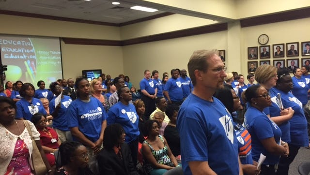 Members of the Jackson Federation of Teachers at the Jackson Public Schools board meeting Tuesday night.