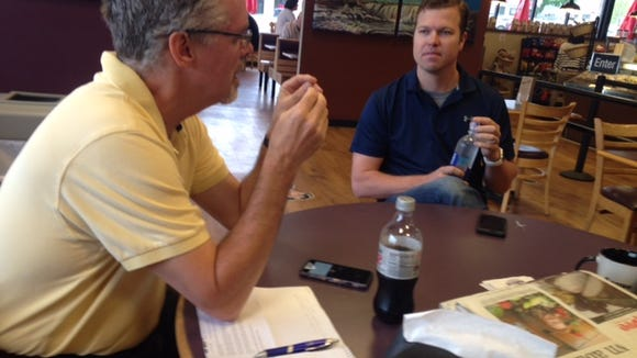 Ben Hanten (right) from Yankton, talks with Argus Leader reporter Steve Young Thursday at Bagel Boy in Sioux Falls about milllennials in the workforce.