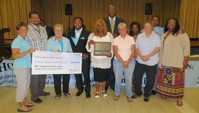 Asbury Park Board Members and administration are recognized by Cenergistic for its energy-saving measures.