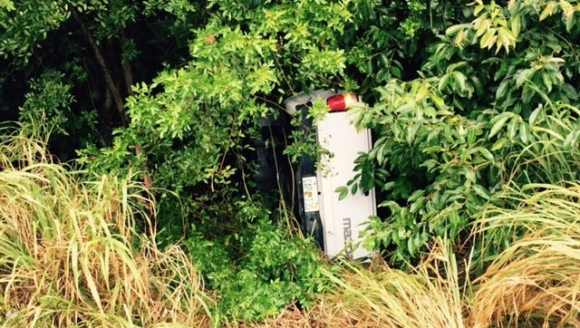 A car traveling on Pineda Causeway overturned in a wooded area in Merritt Island.
