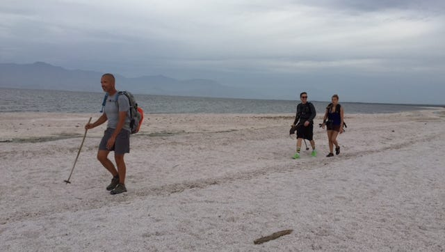 Randy Brown, far left, began walking around the Salton Sea Tuesday - a 116-mile trek he expects to complete by Sunday.