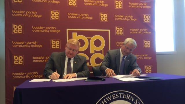 BPCC Chancellor Rick Bateman and NSU President Jim Henderson sign the C4M articulation.
