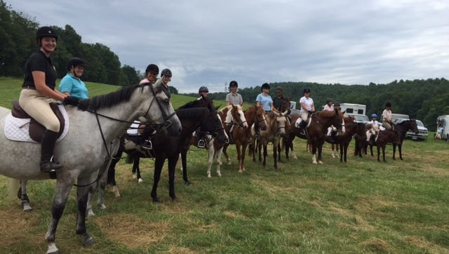 Riders line up before heading out on the trail at Middlebrook Hounds Hunt Club.
