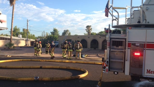 A house fire in Mesa near Lindsey and Brown roads leaves three injured, including two police officers, on Saturday, July 25, 2015.