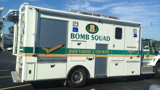 A bomb squad truck arrives at the Merritt Square Mall as Brevard County Sheriffs deputies conduct an investigation.