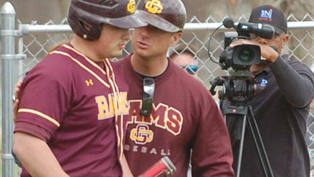 Mike Rucci (middle) has stepped down after three seasons as the coach at Gloucester Catholc