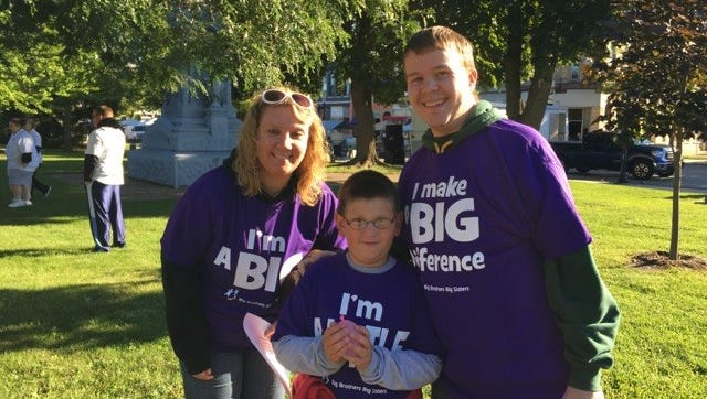 Big couple Angel Oksuita & Garrett Carter pose with their 'Little' Tyler in Veteran's Park during Fondue Fest and the Big Brothers Big Sisters annual 5K run/walk.