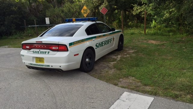 Sheriff's car on scene of possible drowning.