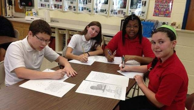 Photo is of some of the SAS students writing their letters