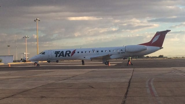 TAR Aerolineas' ERJ-145 jet arrives Thursday at the Abraham González International Airport in south Juárez
