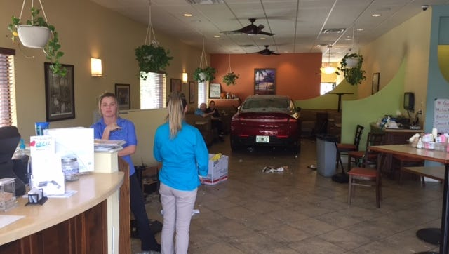 Inside Old 41 Restaurant in Bonita Springs after a car crashed through the restaurant's doors on Sunday.
