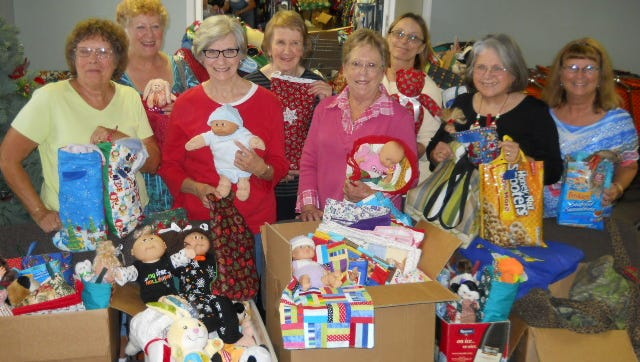 The Material Girls delivered some stockings, doll blankets and tote bags filled with personal care items to Christmas Wish Wednesday. Shown, from left, Sandy Craig, Pat Cromwell, Betty Wooley, Mary Bouras, Joanne Moore, Terry Miller, Stephanie Reubin and Joan Woodward.