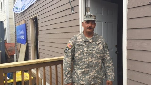 Army veteran Ivan Arroyo stands outside his new home in Yonkers