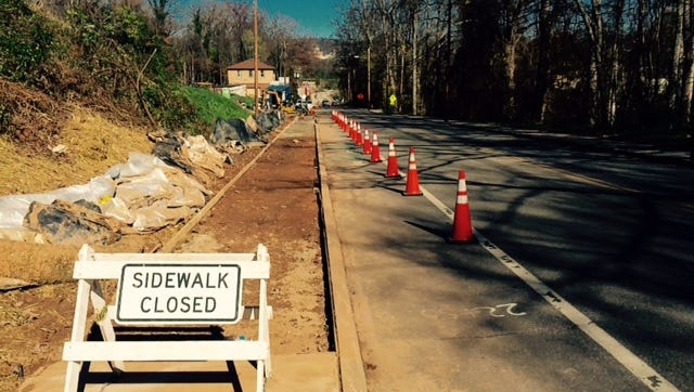 The city of Asheville is partnering with New Belgium Brewing to build new sidewalks on a section of Haywood Street in West Asheville.