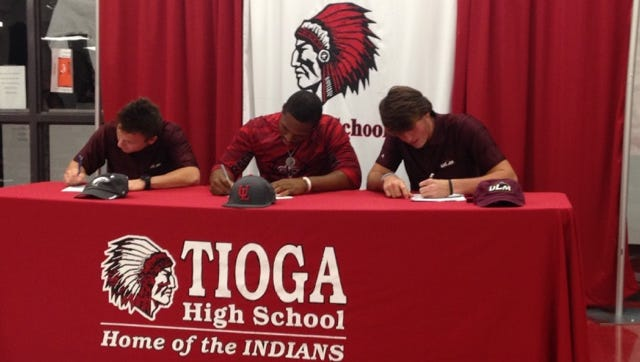 Tioga seniors Brady McGehee (left), Tremaine Spears and Connor Miller sign their National Letters of Intent Thursday.