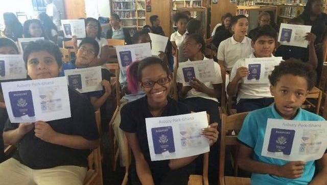 Asbury Park Middle School students, with passports in hand, are ready to travel to Ghana thanks to teleconferencing offered by Polycon.
