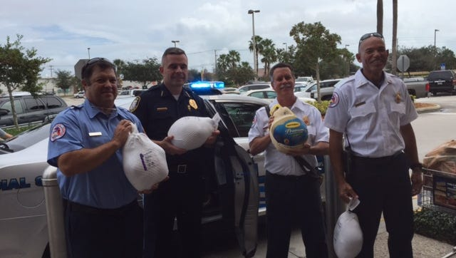 From left to right, Rockledge Fire Department firefighter Mike McCaleb, Rockledge Police Chief Joseph LaSata, Rockledge Fire Department Lt. Scott Hartley and Rockledge Fire Department Lt. Henley Kirkby display donated full turkeys on Saturday.