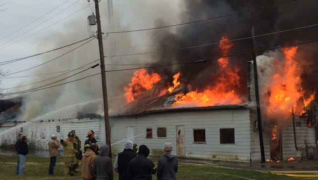Bucyrus Fire Department worked Sunday afternoon to knock down the fire from above and from the ground at the former Eckleberry Poultry building on Spring St.