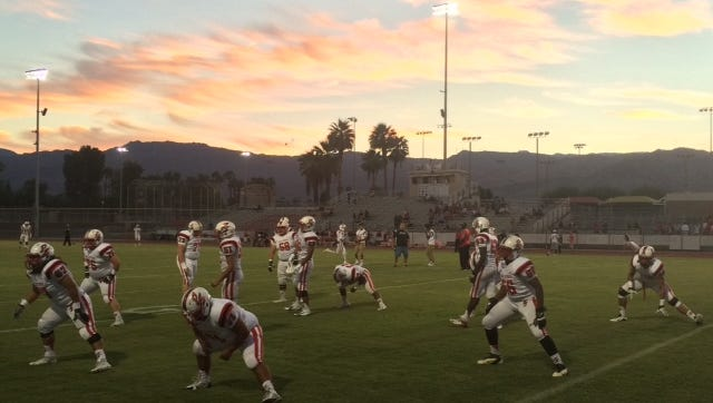 Palm Springs warms at Palm Desert High School under a beautiful desert sunset.