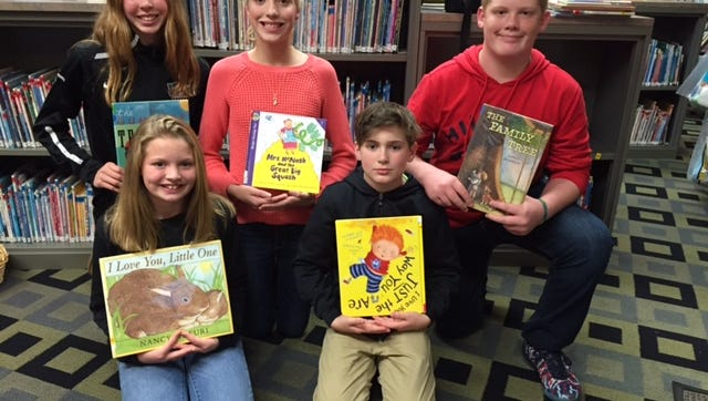 (Front row, from left) Juliana Sharrow and Robert Forrest; and (back row, from left) Emma McKeever, Kayla Vandvelt and Joe Metzger, members of Delsea Regional Middle School's Storytellers Club, shared stories and crafts with Franklin Township area preschoolers during an evening story time at the Franklin Township Library in November.