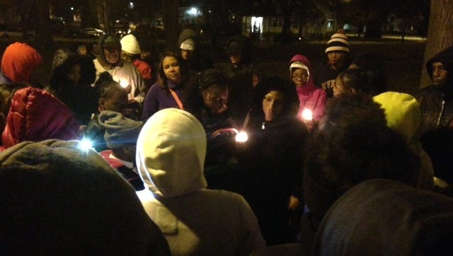 Friends and family of Armani Golden, who was shot and killed in December in Lansing Township, held a candlight vigil in Durant Park shortly after his death. Golden's murder is one of three open homicide investigations in Lansing from 2015.